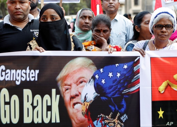Supporters of the Communist Party of India -Marxist protest against the India visit of US President Donald Trump in Mumbai,…