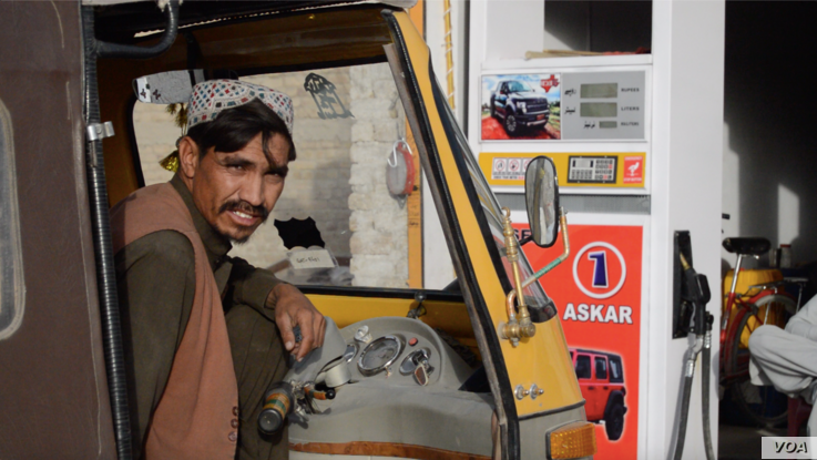 Pakistani driver Jalal filling his vehicle with smuggled Iranian fuel that he said was cheaper legally-sold fuel, on Eastern Byp