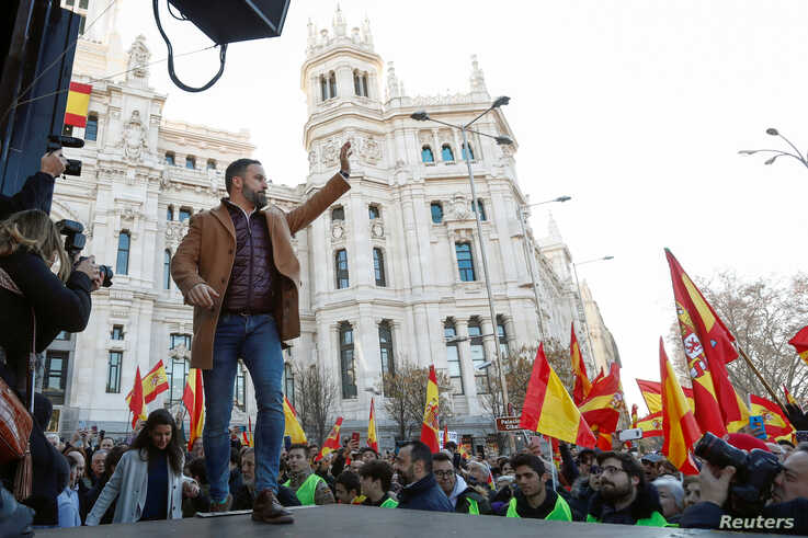Santiago Abascal, leader of the far-right party VOX, waves to supporters during a rally in protest against the new coalition government led by Spain's Prime Minister Pedro Sanchez, at Cibeles Square in Madrid, Spain, Jan. 12, 2020.