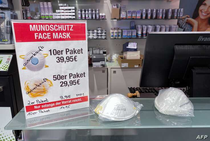 "A sign advertising protective face masks is marked ""Sold out"" inside a store in Berlin, Germany, Feb. 28, 2020."