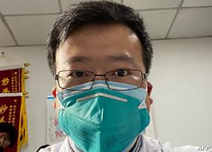 Chinese coronavirus whistleblower, Dr. Li Wenliang, whose death was confirmed on February 7, is shown in his protective mask, at the Wuhan Central Hospital, China.