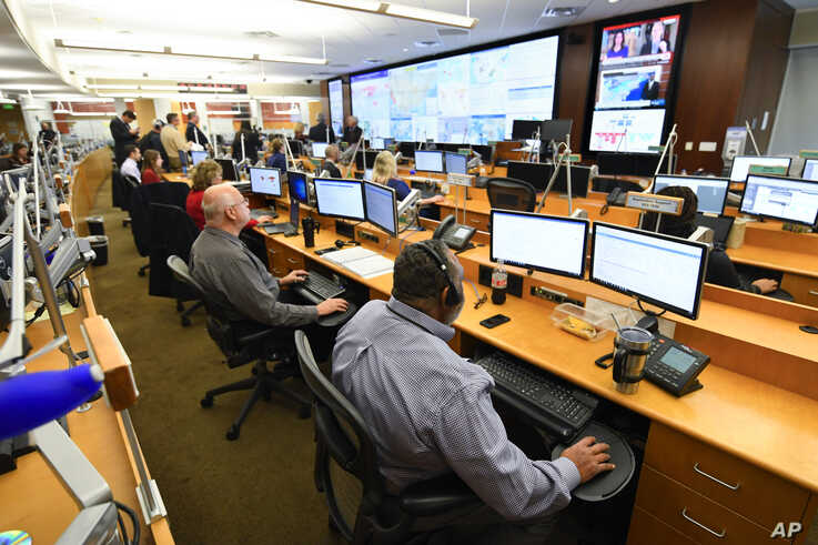 FILE - Personnel at the The Centers for Disease Control and Prevention (CDC) work the Emergency Operations Center in response to the coronavirus, among other threats, Feb. 13, 2020, in Atlanta, Georgia.