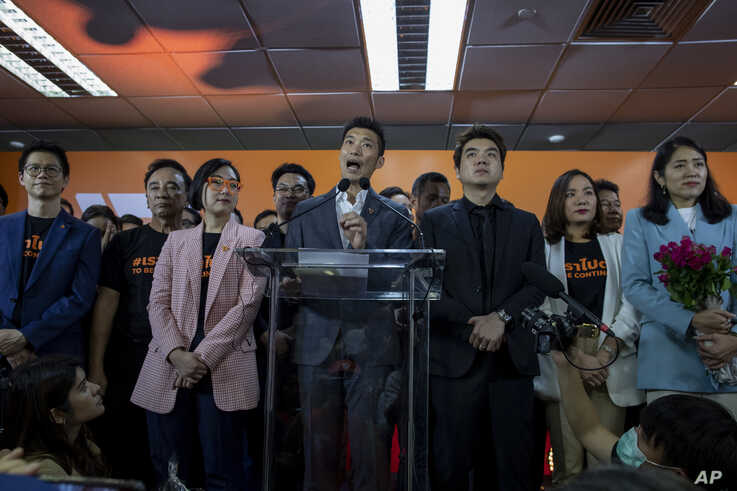 Future Forward Party leader Thanathorn Juangroongruangkit, center, speaks during a press conference after a Thailand's Constitutional Court ordered his party dissolved, in Bangkok, Thailand, Feb. 21, 2020.