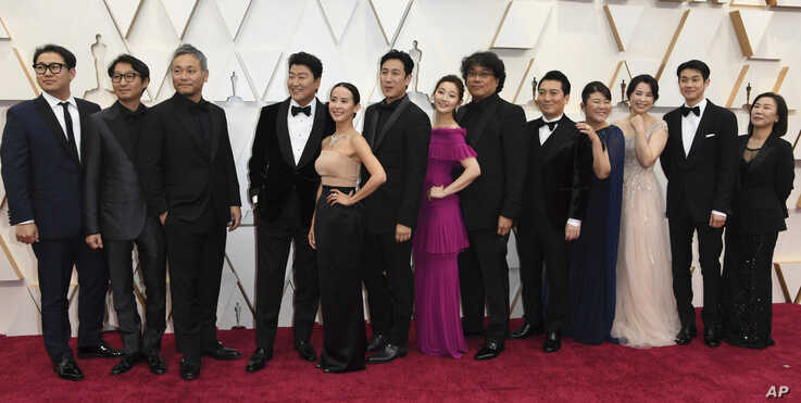 """The cast and crew of """"Parasite"""" arrive at the Oscars, at the Dolby Theatre in Los Angeles, California, Feb. 9, 2020."""