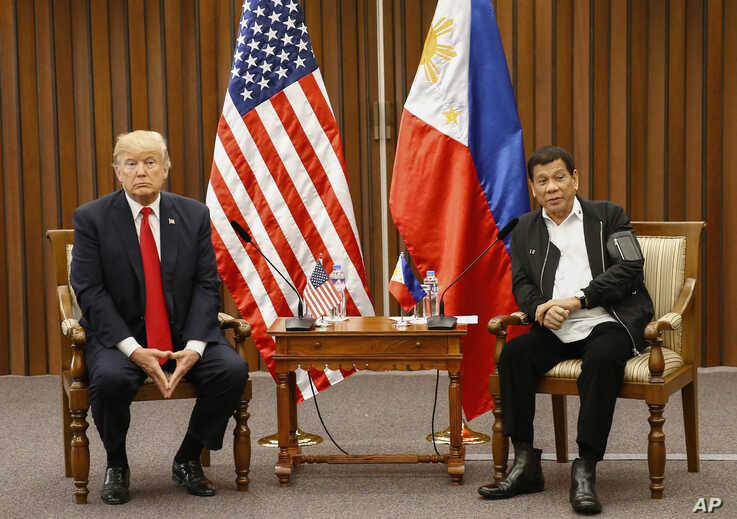FILE - U.S. President Donald Trump, left, and Philippine President Rodrigo Duterte hold a bilateral meeting on the sidelines of an ASEAN Summit in Manila, Philippines, Nov. 13, 2017.
