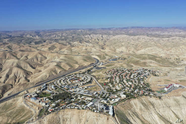 FILE - This Jan. 26, 2020, photo shows a view of the West Bank Jewish settlement of Mitzpe Yeriho. The United Nations Human Rights Council released a list of more than 100 companies it says are operating in Israel's West Bank settlements.
