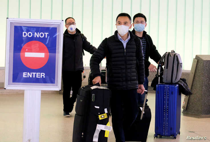 FILE - Passengers arrive at LAX airport from Shanghai, China, before restrictions were put in place to halt the spread of the coronavirus, in Los Angeles, California, U.S., Jan. 26, 2020.