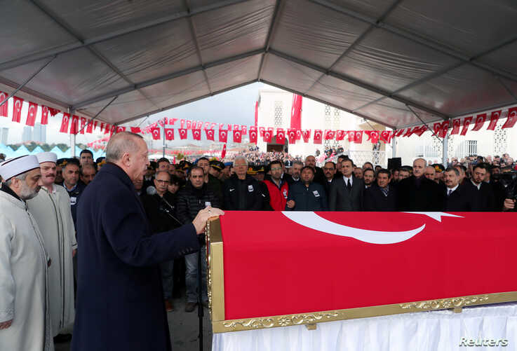 Turkey's President Tayyip Erdogan speaks during the funeral of Turkish soldier Emre Baysal who was killed in Syria's Idlib region, in Istanbul, Turkey, Feb. 29, 2020.