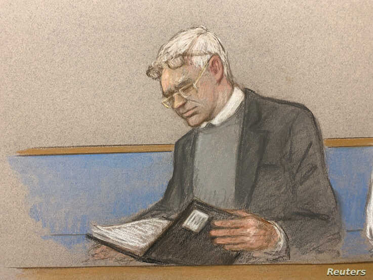 Julian AaJulian Assange wearing two pair of glasses in seen in court during a hearing to decide whether he should be extradited to the United States, in London, Feb. 24, 2020 in this courtroom sketch.ssange wearing two pair of glasses in seen at court during a hearing to decide whether he should be extradited to the…