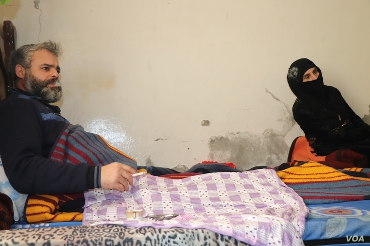Deeb Zara'a, paralyzed from the waist down after being hit by shrapnel in a battle with IS militants, is pictured in Raqqa, Syria, Feb. 22, 2020. He was forced to flee Idlib as there was no one left to help him survive there. (Heather Murdock/VOA)