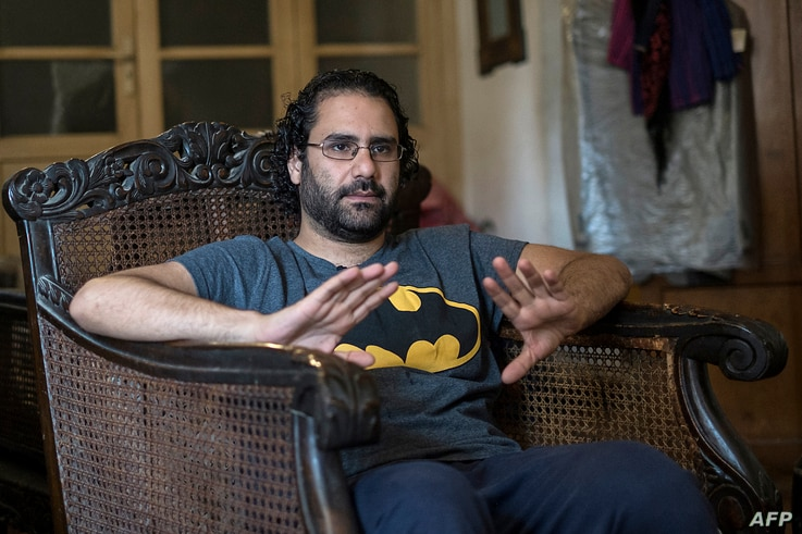 Egyptian activist and blogger Alaa Abdel Fattah gives an interview at his home in Cairo on May 17, 2019. - The days and nights…