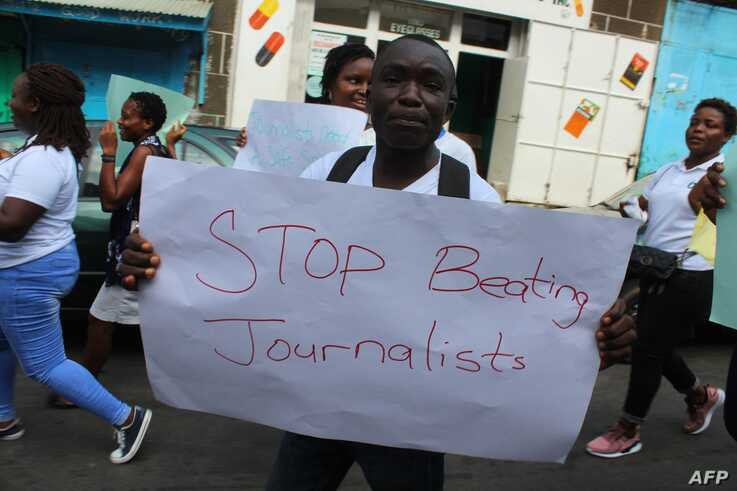 Liberian journalists protest in Monrovia on March 12, 2020 as they rally in the capital Monrovia, and some newspapers darkened…
