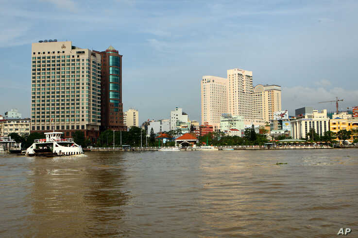 **  TO GO WITH NIVEL DE LOS MARES  **  FILE - In this Sept. 23, 2009 file photo, a riverside view of Ho Chi Minh city center…