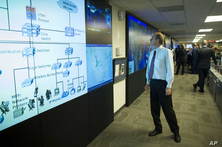 One of the large video screens is checked in the Department of Homeland Security's National Cybersecurity and Communications Integration Center (NCCIC) in Arlington, Va., Aug. 22, 2018.