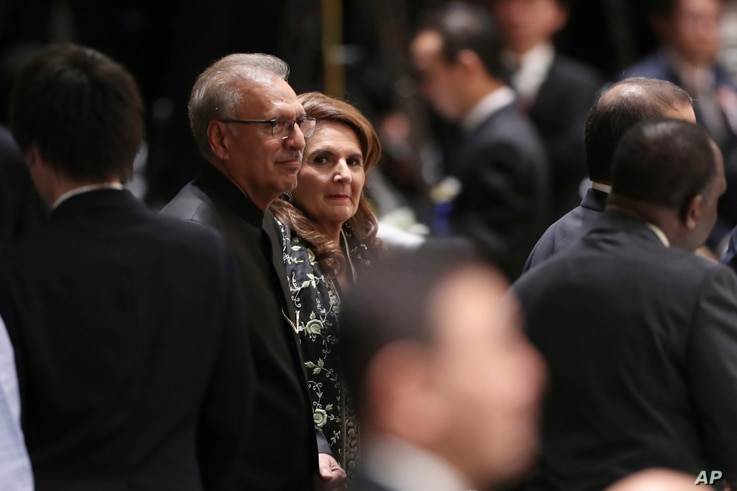Pakistani President Arif Alvi and his wife Samina Alvi attend a banquet hosted by Japan's Prime Minister Shinzo Abe in Tokyo…