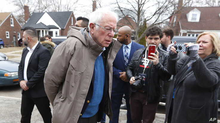 Democratic presidential candidate Sen. Bernie Sanders, I-Vt., visits outside a polling location at Bow Elementary in Detroit.