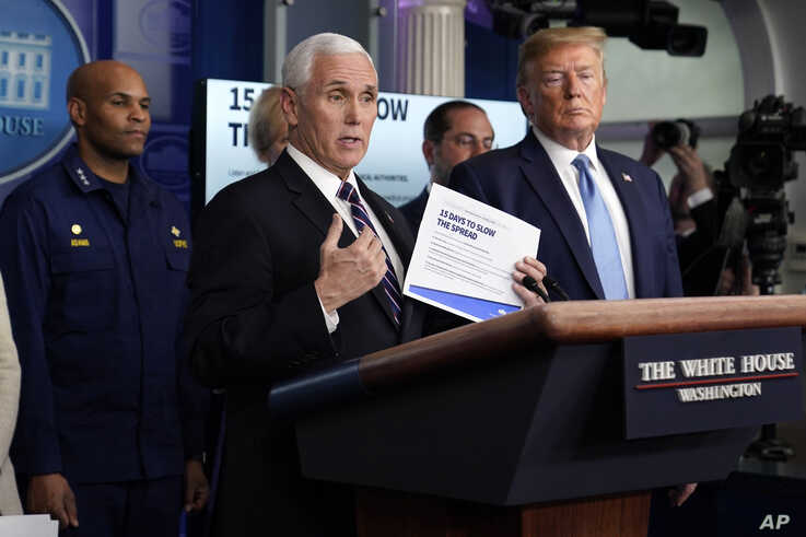 Vice President Mike Pence speaks as President Donald Trump listens during a press briefing with the coronavirus task force, at…