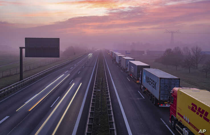 Trucks are jammed in the early morning on Autobahn 12 in front of the German-Polish border crossing near Frankfurt (Oder), Germany, Wednesday, March 18, 2020.