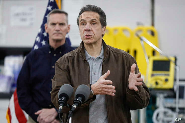 New York Gov. Andrew Cuomo speaks during a news conference alongside the National Guard at the Jacob Javits Center that will…