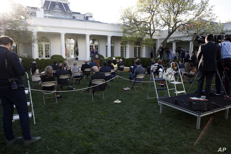 President Donald Trump speaks about the coronavirus in the Rose Garden of the White House, Monday, March 30, 2020, in…