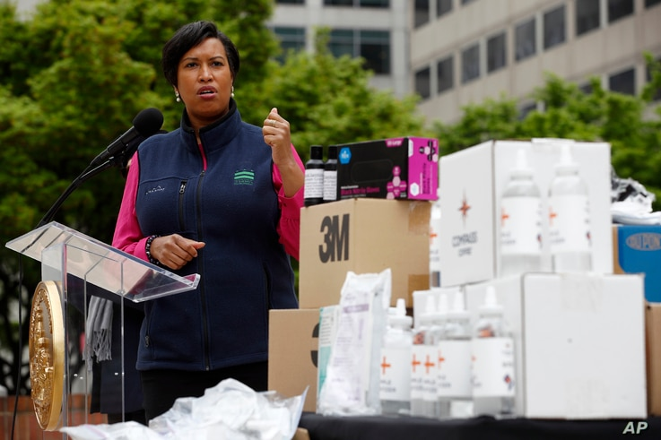 District of Columbia Mayor Muriel Bowser speaks about the District's coronavirus response in front of a table of hand sanitizer…
