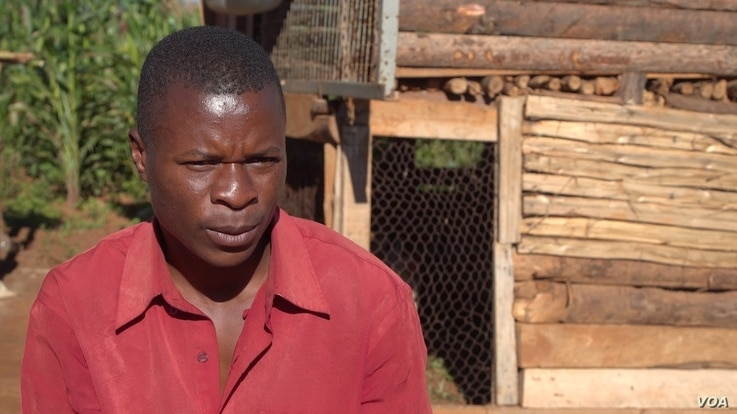 Muchaneta Maputire, who lost his home last year in Cyclone Idai, is still waiting to get into permanent housing, in Chimanimani district, Zimbabwe, March 14, 2020. (Columbus Mavhunga/VOA)