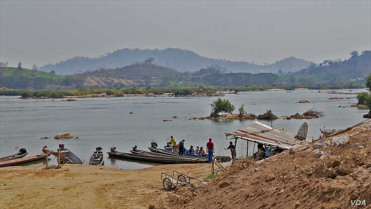 Local villagers travel on the Mekong River near Nong Khai, Thailand. The river's water has become clear since the Xayaburi dam u