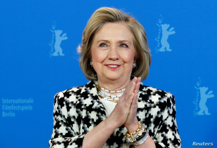 """Hillary Clinton gestures as she attends a photo call to promote the movie """"Hillary"""" during the 70th Berlinale International…"""