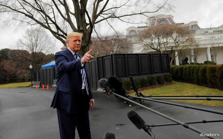 U.S. President Donald Trump answers questions from reporters in front of the West Wing of the White House as he departs to…