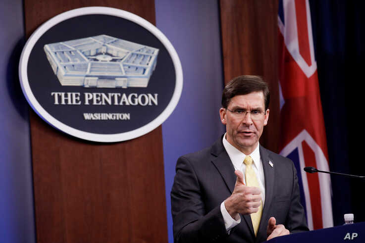 U.S. Defense Secretary Mark Esper gestures as he speaks during a joint news conference with Britain's Secretary of State of…