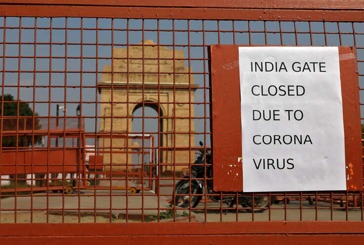 A sign pasted on a security barricade is seen after the India Gate war memorial was closed for visitors amid measures for…