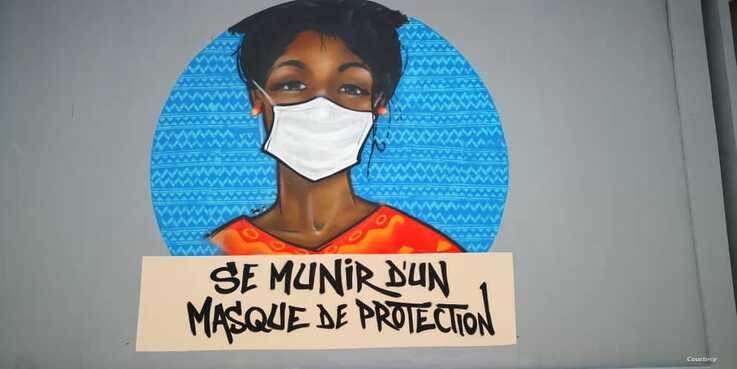 This image created by graffiti collective RBS highlights the need to wear face masks as the coronavirus continues to spread. (Alpha Sy)