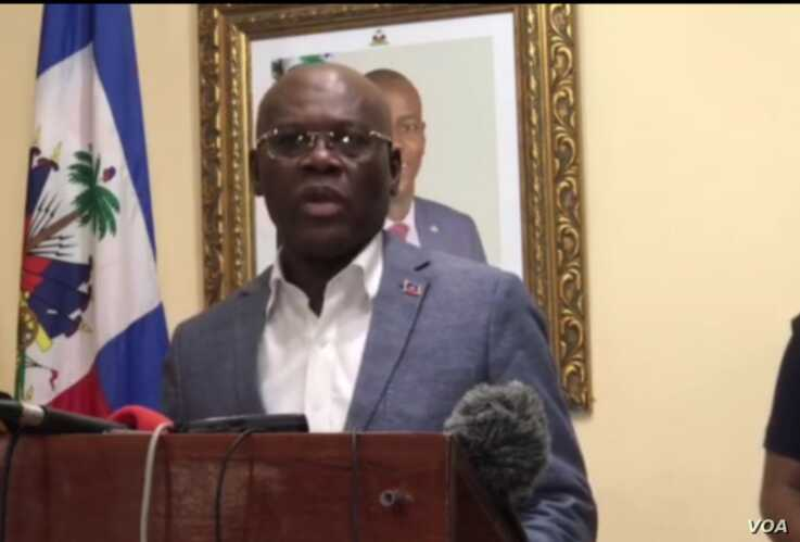 Haiti's Prime Minister Joseph Jouthe announces tighter travel restriction will go into effect Monday March 16 at midnight. (VOA/Renan Toussaint)