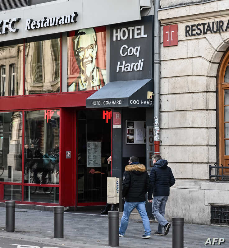 People walk in front of the Coq Hardi hotel near the train station in central Lille, northern France, Feb. 11, 2020, where Chechen blogger Imran Aliev was found dead on Jan. 30, 2020, by French emergency services.