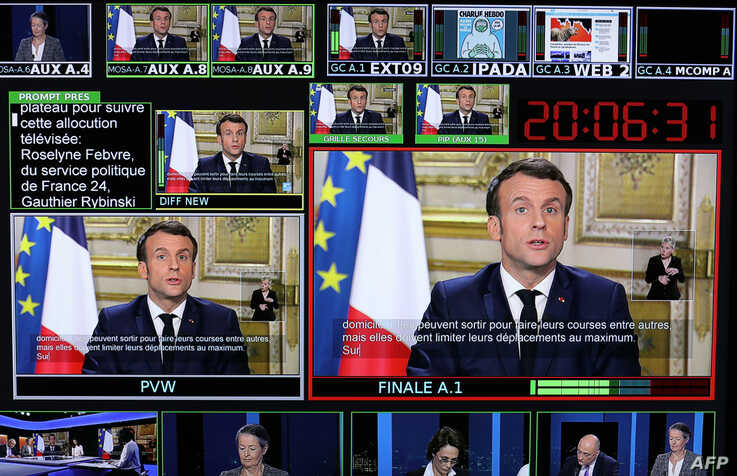 Screens show France's President Emmanuel Macron addressing the nation about the coronavirus outbreak, at TV broadcast studios of the France 24 channel, in Issy-Les-Moulineaux, near Paris, France, March 12, 2020.