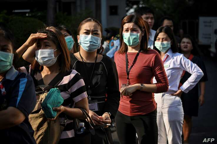 People line up to buy face masks amid concerns about the spread of the coronavirus, outside a shopping mall in Bangkok, Thailand, March 5, 2020.