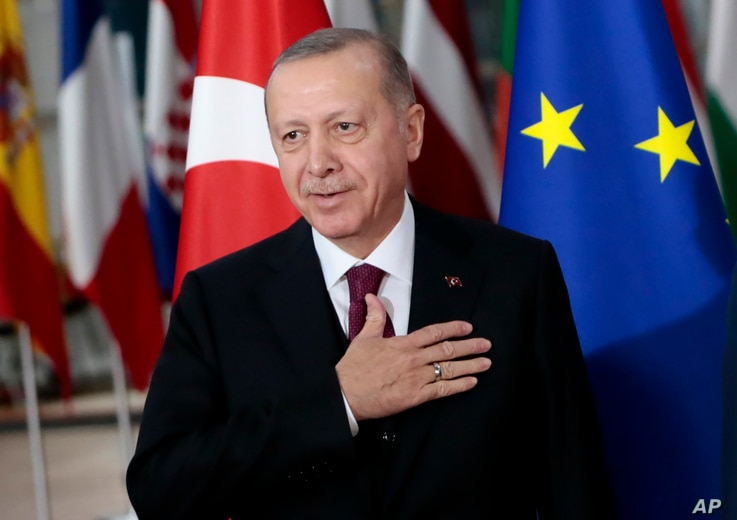 Turkish President Recep Tayyip Erdogan gestures prior to a meeting  at the European Council building in Brussels, Belgium, March 9, 2020.