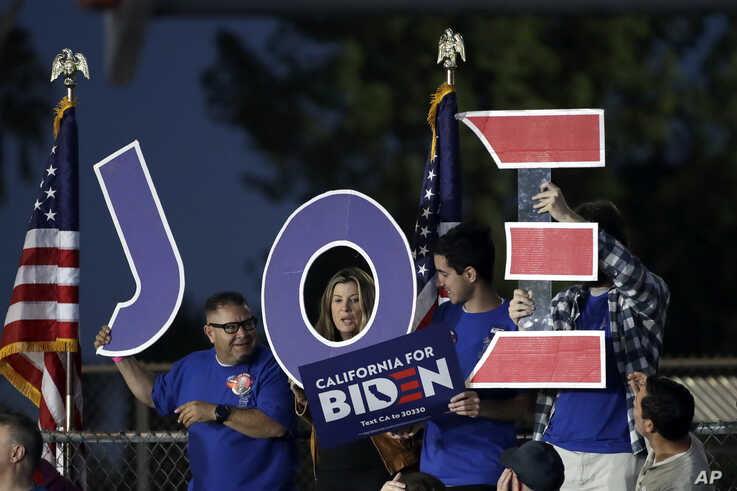 Supporters hold a sign before a campaign rally for Democratic presidential candidate former Vice President Joe Biden, March 3, 2020, in Los Angeles.