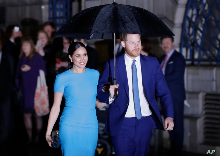 Britain's Prince Harry and Meghan, the Duke and Duchess of Sussex arrive at the annual Endeavour Fund Awards in London.
