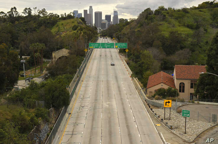 Hardly any cars move along the 110 Harbor Freeway toward downtown, in Los Angeles, California, March 20, 2020.