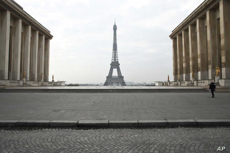 A police officer walks in the empty Trocadero square in Paris, France, March 18, 2020.