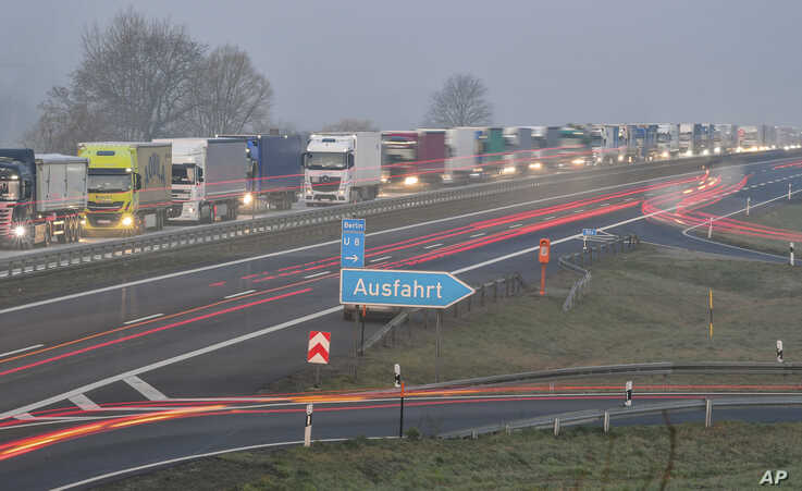 Trucks are jammed in the early morning on Autobahn 12 as they approach the German-Polish border crossing near Frankfurt-an-der-Oder, Germany, March 18, 2020.