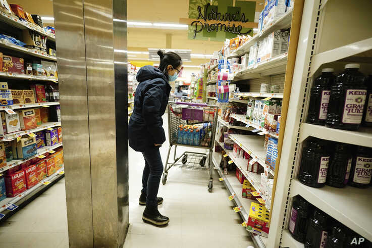 New Yorkers wear protective masks and strip store shelves of supplies as the coronavirus continues to wreak havoc throughout the city, Mar 13, 2020.