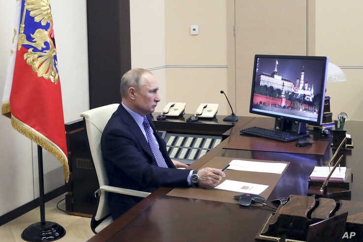 Russian President Vladimir Putin chairs a meeting with Russian regional officials via videoconference at the Novo-Ogaryovo residence outside Moscow, March 30, 2020.