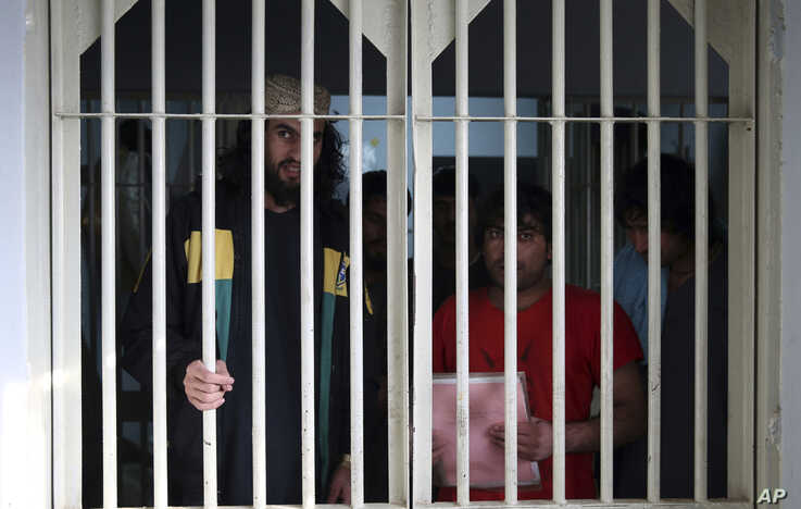 FILE - Jailed Taliban fighters are seen inside the Pul-e-Charkhi prison in Kabul, Afghanistan, Dec. 14, 2019.