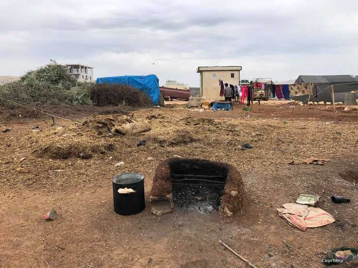 In the countryside of Idlib, families have been fleeing bombs for months, and many are now living out in the open, cooking on ovens they made themselves, March 1, 2020. (Courtesy of aid workers)