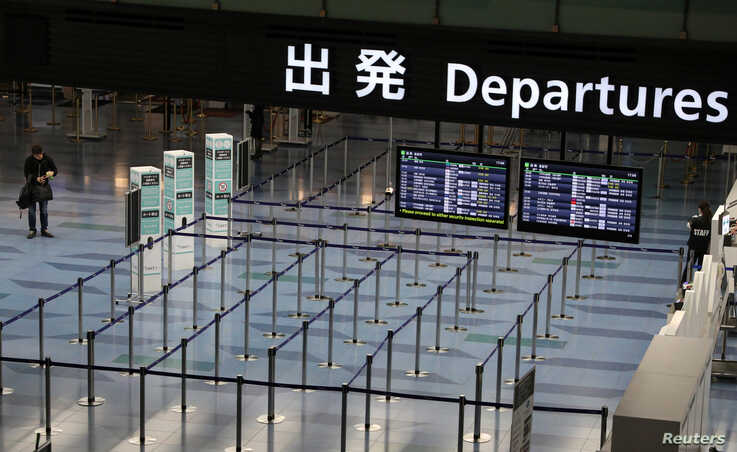 An empty departures are is pictured at Haneda Airport in Tokyo, Japan, March 4, 2020.