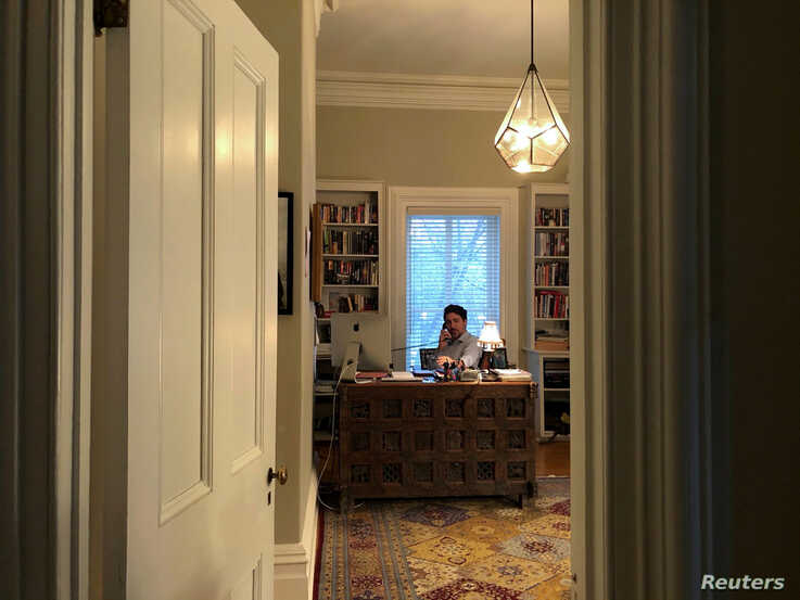 Canada's Prime Minister Justin Trudeau works from his home office at Rideau Cottage in Ottawa, Canada, March 13, 2020, during his self-quarantine, after his wife Sophie Gregoire tested positive for the coronavirus. (Prime Minister's Office via Reuters)