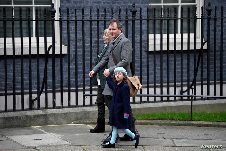 Richard Ratcliffe, the husband of Nazanin Zaghari Ratcliffe, his daughter Gabriella and his mother arrive at Downing Street in London, Jan. 23, 2020.