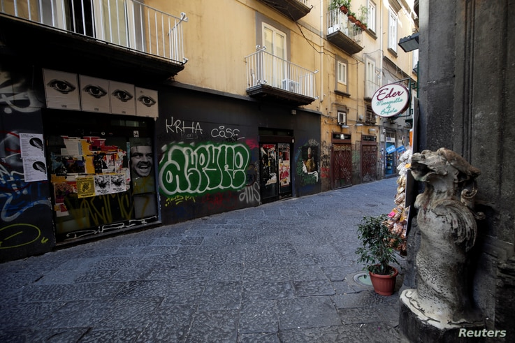 A view of an empty street on the second day of an unprecedented lockdown across all of the country, imposed to slow the outbreak of coronavirus, in Naples, Italy, March 11, 2020.